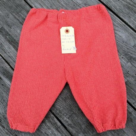 Lange bukser med rød/orange tern